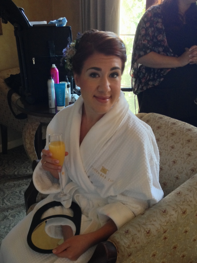 Sarah with a Mimosa getting ready for the wedding.