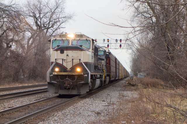 Westbound auto rack train splits the uprights in Riverside, Illinois