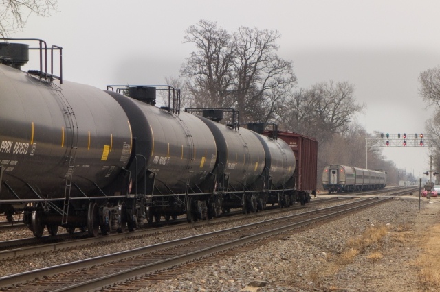 Oil train passing an Amtrak at Riverside, IL