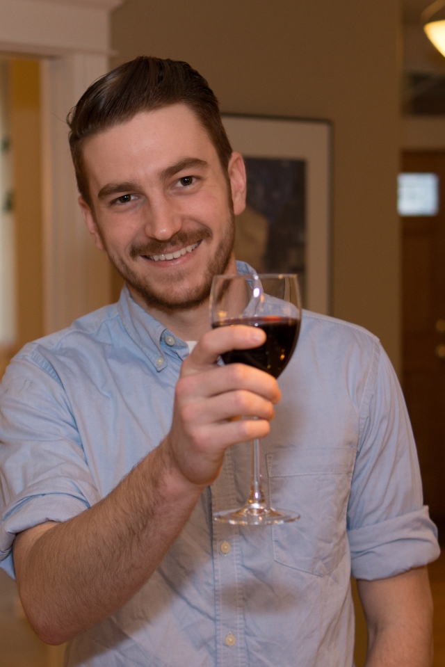 Kevin receiving a toast for his graduation