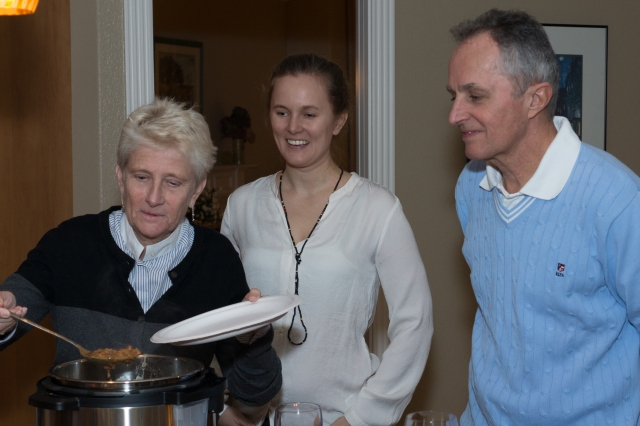 Emmy with her parents Evalotta and Roald dishing up dinner