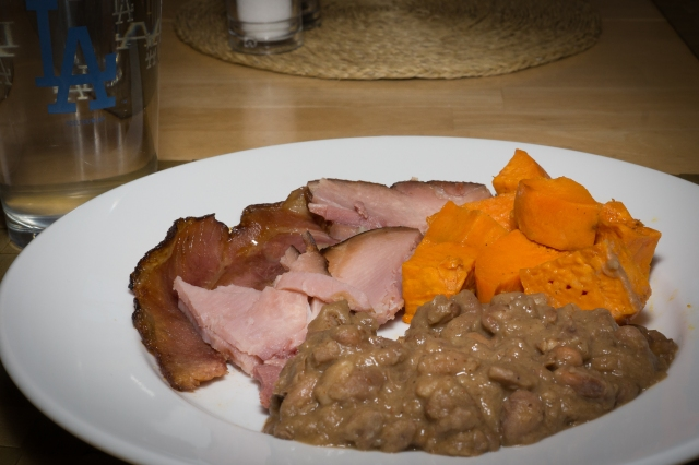 Dinner (leftovers) are served: ham, yams, and delicious pinto beans.