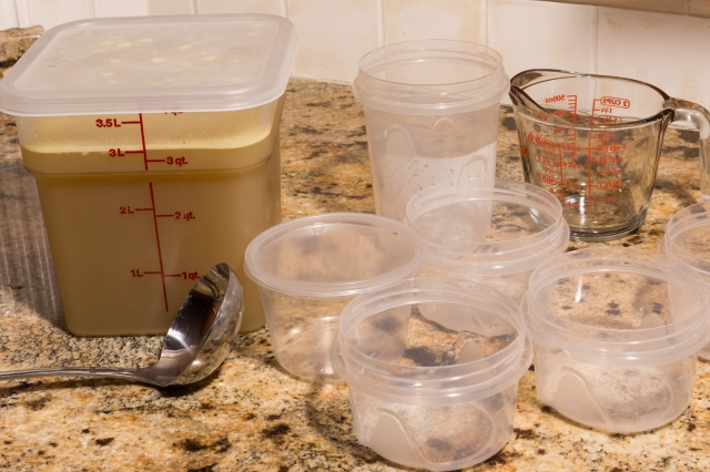 Ready to dish the chicken stock into manageable containers for freezing