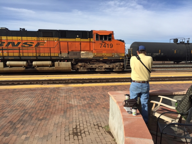Howard photographing a BNSF freight at La Posada