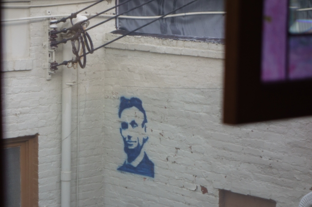 Image of Abraham Lincoln on a wall outside Guzzardos Restaurant in Lincoln, Illinois
