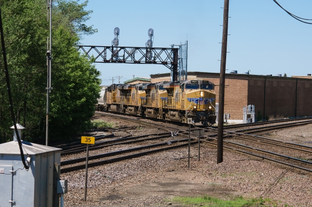 Eastbound Union Pacific pounding the diamon at Rochelle Railroad Park, Illinois
