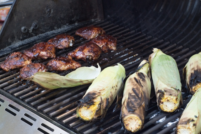 Grilling chicken thighs with corn on the cob