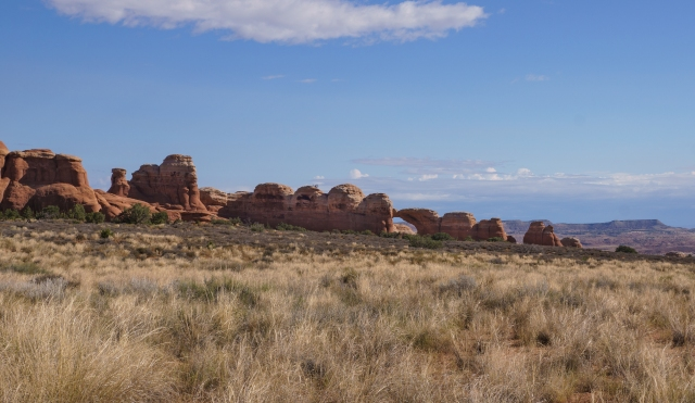 View from the trail looking at Broken Arch - Arches National Park