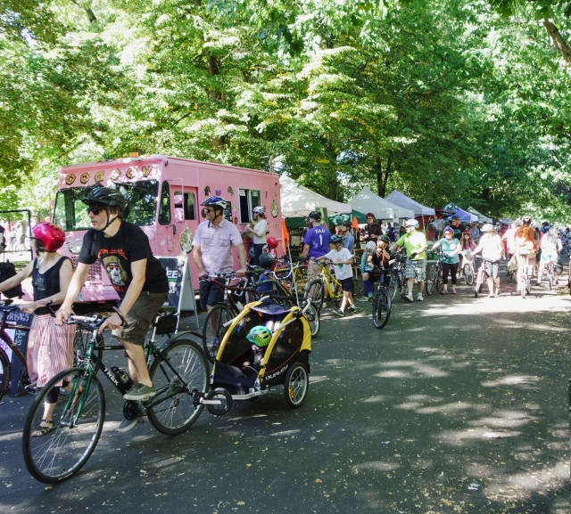 Bike riders and booths at Portland Sunday Parkways - Southeast