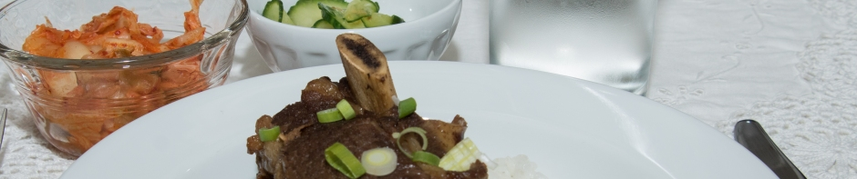 Korean style short ribs with cucumber and kim chi banner photo