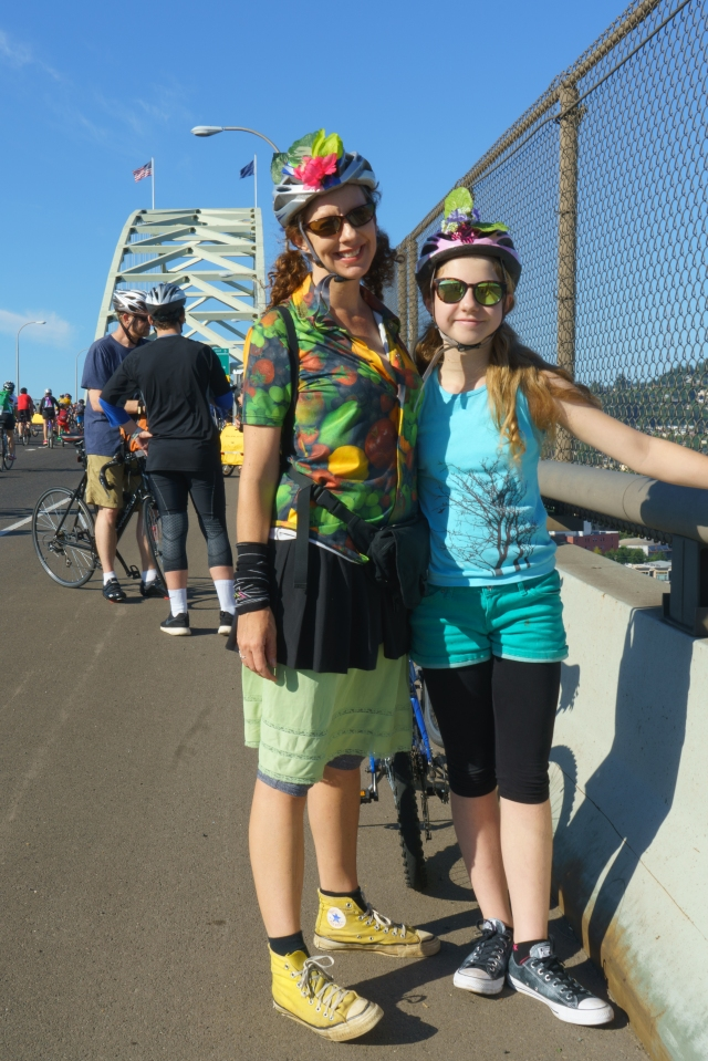 Mother and daughter with fancy bike helmets on the Fremont Bridge