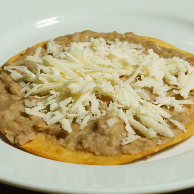 Refried beans topped with cotija cheese.
