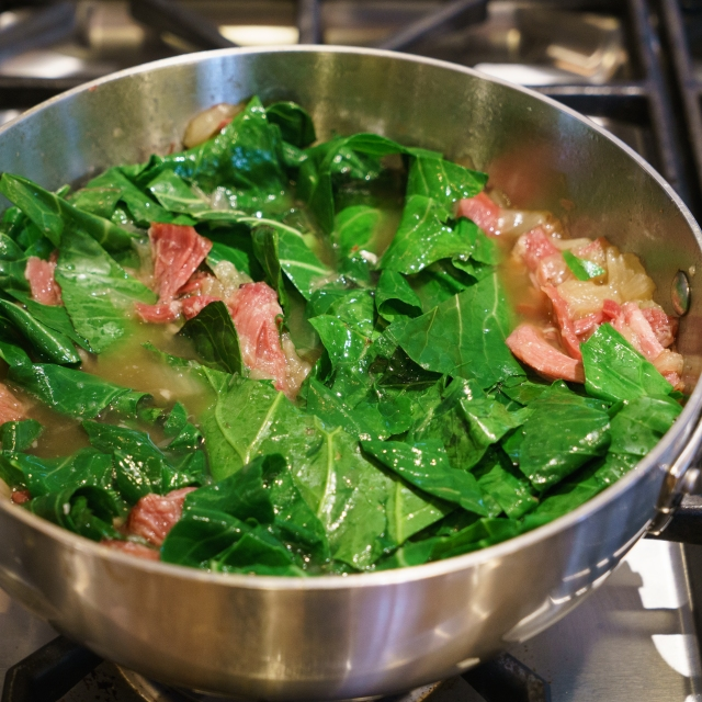 Collard greens in chicken and ham hock broth