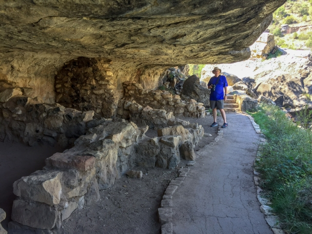 The author looking at the ruins of a dwelling in Walnut Canyon National Monument. Photo credit: Carla